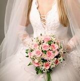 Bouquet of roses in bride's hands. Stock Photo