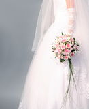 Bouquet of roses in bride's hands. Stock Photos