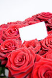 A bouquet of roses with a business card. Beautiful Stock Photography