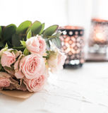 Bouquet of roses and candles Royalty Free Stock Image