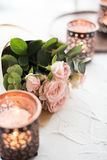Bouquet of roses and candles Royalty Free Stock Photography