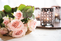 Bouquet of roses and candles Royalty Free Stock Images
