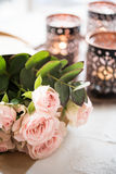 Bouquet of roses and candles Stock Photos