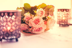 Bouquet of roses and candles Stock Image