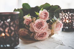 Bouquet of roses and candles Stock Photo