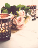 Bouquet of roses and candles Royalty Free Stock Photo