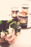 Bouquet of roses and candles Stock Images