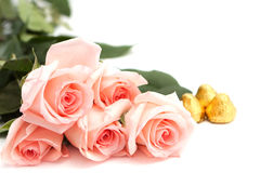 Bouquet of roses and candy Royalty Free Stock Photos