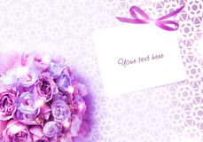 Bouquet of roses and a card on lace background. A festive mood for a wedding or family celebration. There is a place for text. A light background will draw Royalty Free Stock Photos