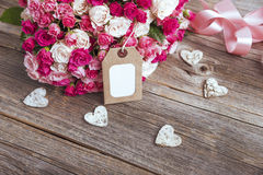 Bouquet of roses and card. Royalty Free Stock Photography