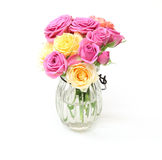 Bouquet of roses and carnation in a glass bottle Royalty Free Stock Images