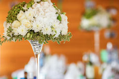 A bouquet of roses and chamomiles in a glass vase Stock Photography