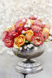 Bouquet of roses and chrysanthemums in vintage silver vase Stock Images