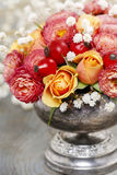 Bouquet of roses and chrysanthemums in vintage silver vase Stock Image