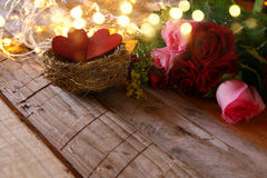 bouquet of roses and couple of red hearts in the nest Royalty Free Stock Images