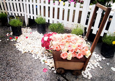 Bouquet of roses decoration. Bouquet of roses against wooden toy car wedding decoration Stock Photos