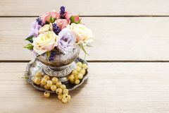 Bouquet of roses and eustomas in vintage silver vase Stock Photo