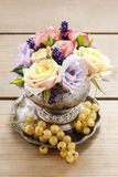 Bouquet of roses and eustomas in vintage silver vase Royalty Free Stock Images
