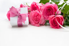 Bouquet of roses and gift box Royalty Free Stock Photo