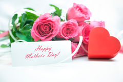 Roses and gift box with a card Stock Photo