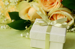 Bouquet of roses and gift box Stock Image