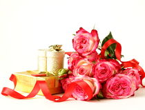 Bouquet of roses and gift box Stock Photography