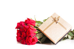 Bouquet of roses and a gift Royalty Free Stock Photo