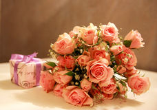 Bouquet of Roses and a gift Royalty Free Stock Image