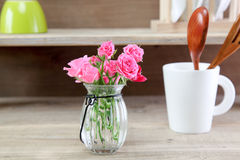 Bouquet of roses in a glass bottle Stock Photos