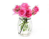 Bouquet of roses in a glass bottle Royalty Free Stock Photos