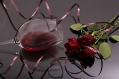 Bouquet of roses and glass red wine on black Royalty Free Stock Photography