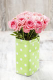 Bouquet of roses in green dotted can