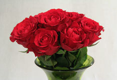 Bouquet of roses in a green vase royalty free stock image