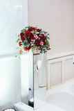 Bouquet of roses and greenery stands  on the glass box Stock Photo