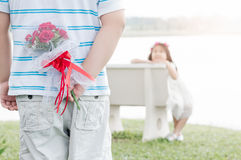 Bouquet Roses in hand man for little bride Royalty Free Stock Image