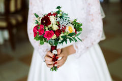 Bouquet of roses in the hands bride royalty free stock image
