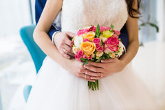 Bouquet of roses in hands of the bride Stock Image