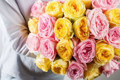 Bouquet of roses in hands  the florist.. Color pink. Royalty Free Stock Photo