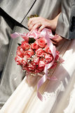 Bouquet with roses in the hands of newly-married Royalty Free Stock Photo