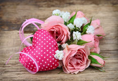 Bouquet of roses and heart Stock Photography