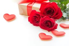 Bouquet of roses and hearts on white background. Valentine`s card. Close up. Stock Images