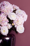 Bouquet of roses and hydrangea in a vase Stock Photos