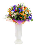 Bouquet of roses, iris, alstroemeria, nerine and other flowers. Delicate beautiful bouquet of roses, iris, alstroemeria, nerine and other flowers with colored Stock Images