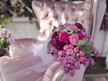 Bouquet of roses and lilac Stock Images