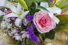 Bouquet of roses and lilies Royalty Free Stock Image