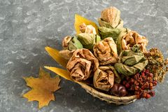 Bouquet of roses made from autumn maple leaves royalty free stock photos