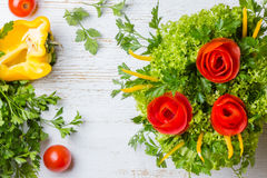Bouquet of roses made from tomatoes and lettuce, white background. Bouquet of roses made from tomatoes, bell pepper, lettuce on white background Royalty Free Stock Photography