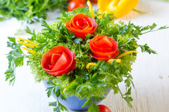 Bouquet of roses made from tomatoes and lettuce, white background. Bouquet of roses made from tomatoes, bell pepper, lettuce on white background Stock Image