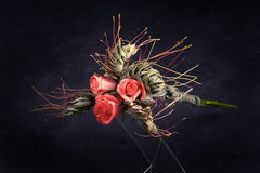 Bouquet of roses and maple leaves. Beautiful bride's bouquet of roses and maple leaves on a dark background Stock Photos