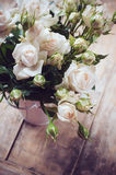 Bouquet of roses in metal pot Royalty Free Stock Photos